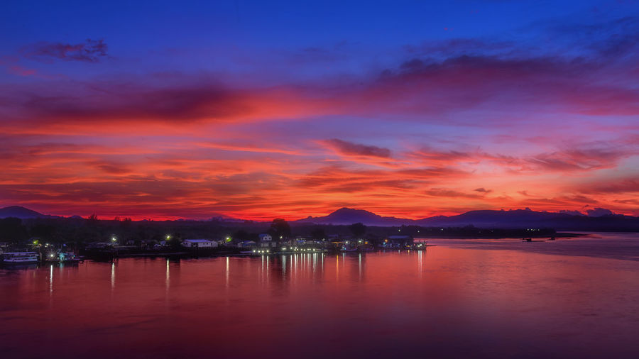 Sky Water Cloud - Sky Reflection Sunset Scenics - Nature Beauty In Nature Tranquility Illuminated Nature Tranquil Scene No People Mountain Waterfront Dusk Lake Orange Color Night Outdoors Light Romantic Sky Phuket Thailand