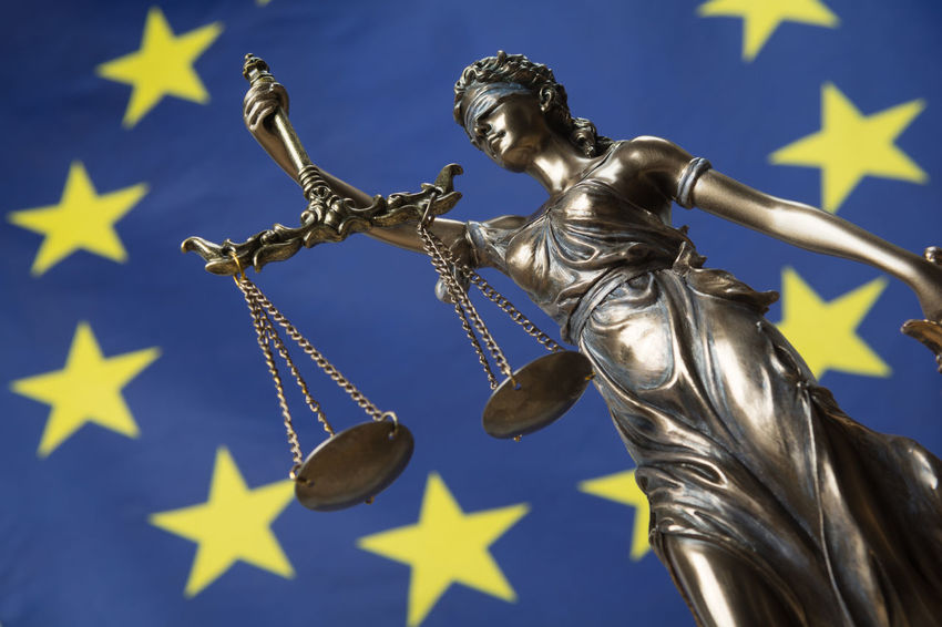 Statue of the blindfolded goddess of justice Themis or Justitia, against an European flag, as a legal concept Authority Court Decisions Democracy European Union Lady Justice Politics Rules Statue Concept Courthouse Eu Europe Flag Gavel Goddess Judge Judgement Justice Law Legal Legislation Order Symbol System