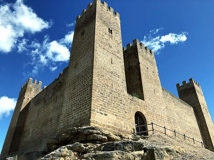 History Stone Sky Mudéjar Castle Architecture Sky Low Angle View History Built Structure The Past Nature Building Exterior Day Sunlight Ancient Building Cloud - Sky Travel Destinations No People Tower Outdoors Blue Travel Tall - High