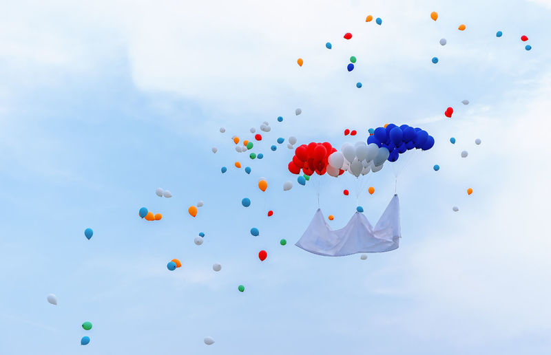 Low angle view of balloons against sky