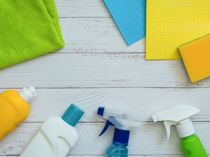 House cleaning products on white wooden background with copy space. Hygiene and cleanliness consept Cleaning Products Background Household House Top View Service Bottle Hygiene Chemical Detergent Product Domestic White Clean Equipment Spring Housekeeping Concept Set Liquid Plastic Spray Home Business Tool Table Cleaner Copy Space Purity Fluid Housework Sponge Sanitary Cleanup Rag Rubber Cleanser Disinfect Scouring Wood Color Wooden Antibacterial Cleanliness Indoors  High Angle View Still Life No People Directly Above Green Color Yellow Blue