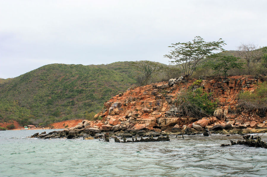 rocky coastline in mochima national park Mochima National Park Architecture Beauty In Nature Day Nature No People Outdoors Rock - Object Sea Sky Tree Tropical Water Waterfront
