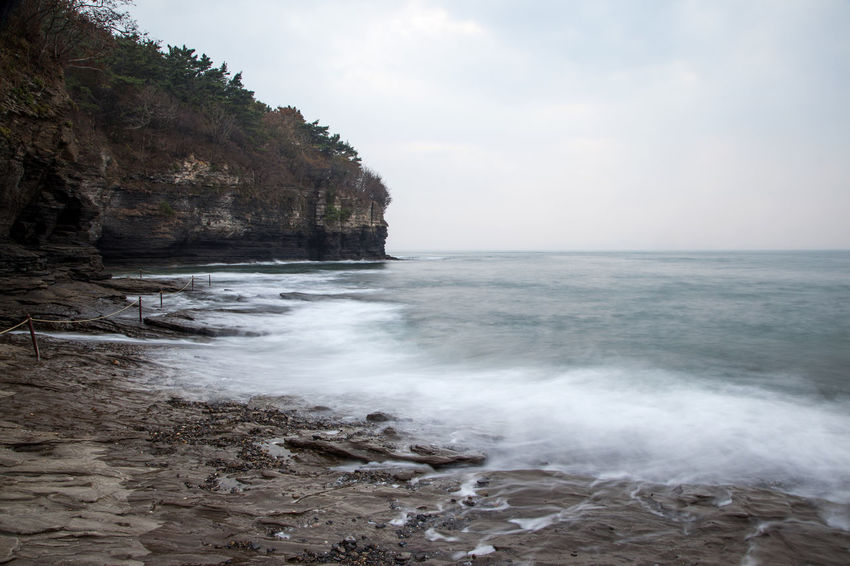 long exposure view of Chaeseokgang, a famous cliff seaside in Byeonsan, Jeonbuk, South Korea Beauty In Nature Chaeseokgang Day Horizon Over Water Long Exposure Nature No People Outdoors Rock - Object Scenics Sea Seaside Sky Tranquility Water