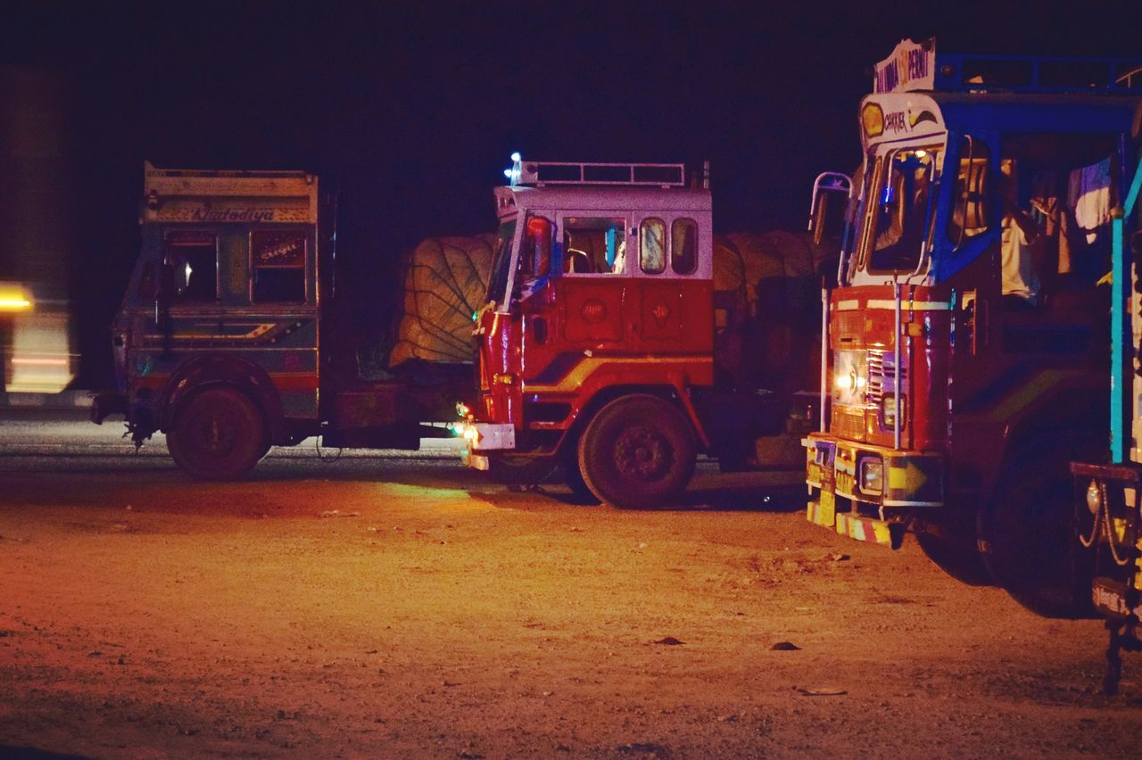 land vehicle, transportation, mode of transportation, night, truck, men, occupation, street, city, road, working, outdoors, industry, motor vehicle, architecture, illuminated, business, fire engine, semi-truck, real people