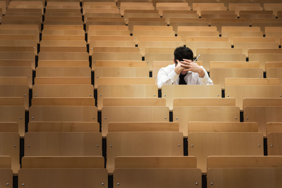 auditorium at a university Learning Student Auditorium Chair Classroom Day Education In A Row Indoors  Learning Lecture Hall Lifestyles Men One Person People Performance Real People Seat Sitting Student University University Student Young Adult