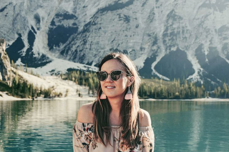 Portrait of beautiful woman in lake