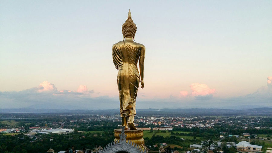 Large Buddha Statue Against Townscape