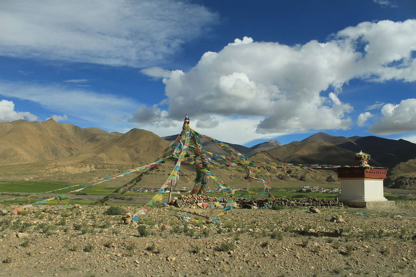 Chorten Tibet Travel Tibetan Buddhism Beauty In Nature Buddhism Cloud - Sky Day Field Grass Landscape Mountain Mountain Range Nature No People Outdoors Scenics Sky Spirituality Tibet Tibetan Culture Tibetan Prayer Flags Tranquility