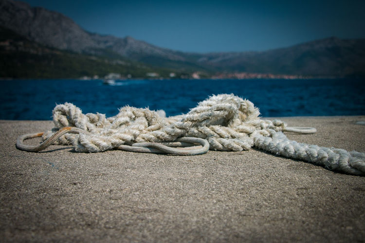 Close-Up Of Rope On Pier At Harbor
