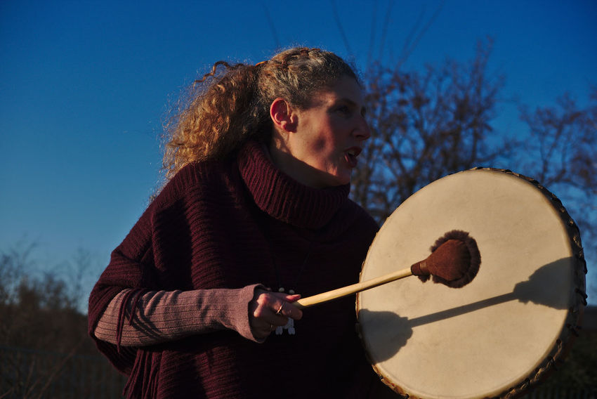 Potrait of Raphaela Gilla with her shaman drum Adult Clear Sky Day Music Musical Instrument Musician One Person Outdoors People Playing Potrait Potrait Of Woman Potrait_photography Real People Shaman Shaman Drum Shamanic Shamanism Shamans_photo Sky Wild Young Adult