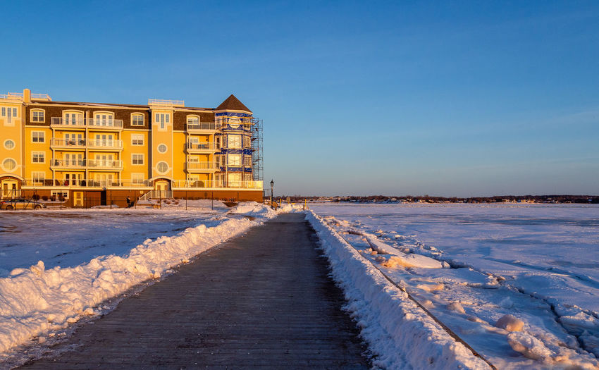 The building during the sunset in the winter Afternoon Charlottetown Freezing Ice Road Snow ❄ Winter Blue Building Canada Day Daylight No People Outdoors Prince Edward Island Sea Sky Snow Sunset Waterfront