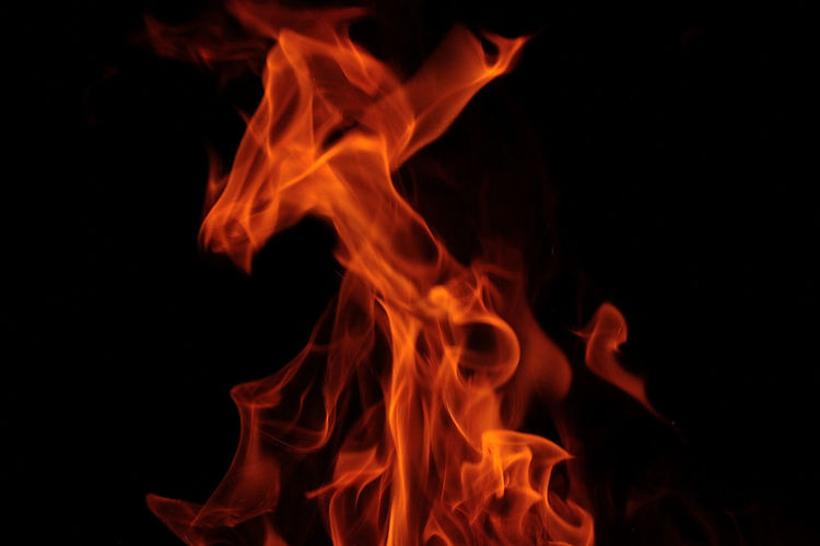 Close-up of flames against black background