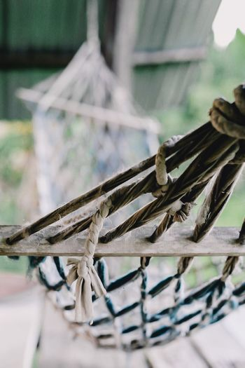 Close-up of rope tied to chair