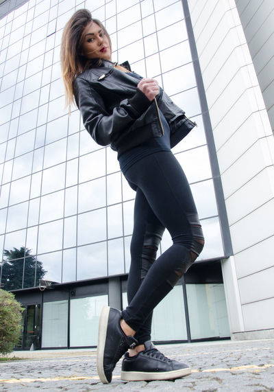 fashion clothing autumn winter One Person Young Adult Full Length Real People Architecture Young Women Day Built Structure Clothing Window Low Angle View Shoe Adult Well-dressed Lifestyles Hairstyle Side View Outdoors