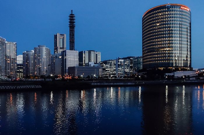 The City Light Evening Light On The River Riverside Skyscraper Building Exterior Built Structure Architecture Blue Sky No Clouds In The Sky Waterfront No People Urban Skyline Clear Sky Illuminated Cityscape Cityscape City Life From My Point Of View The Evening Sky The Evening Yokohama Ultimate Japan Yokohama, Japan May 2017