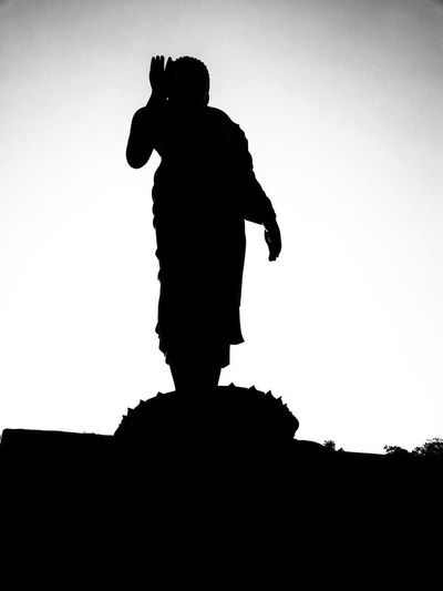 Low angle view of silhouette man standing against clear sky