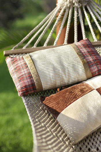 Cribs and Pillows Cot Cribs Checked Pattern Clothing Cradle Mountain Focus On Foreground Holding Outdoors Pillows Selective Focus Sunlight Textile Wood - Material Wooden Fabric