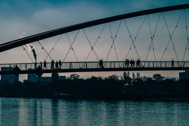 Footbridge over river at dusk