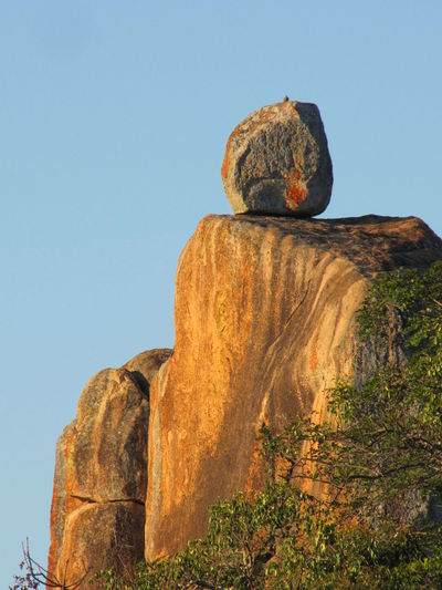 Low angle view of rock formation against clear blue sky in zimbabwe