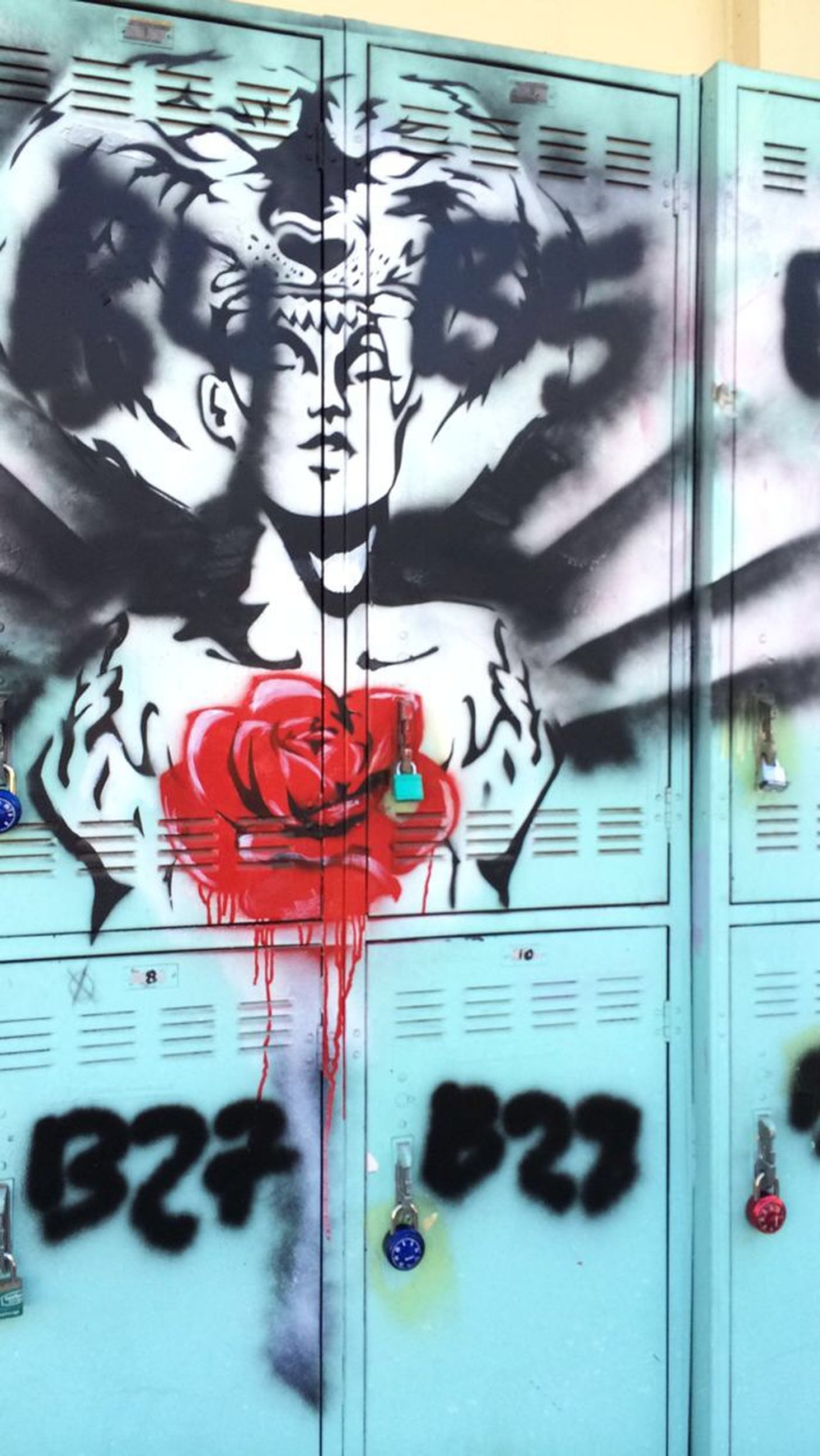 indoors, creativity, art and craft, communication, art, text, red, western script, wall - building feature, close-up, painting, graffiti, reflection, wall, human representation, glass - material, ideas, built structure, day