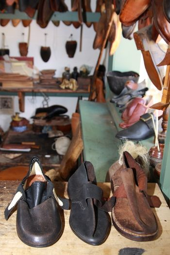 Shoes On Table In Workshop