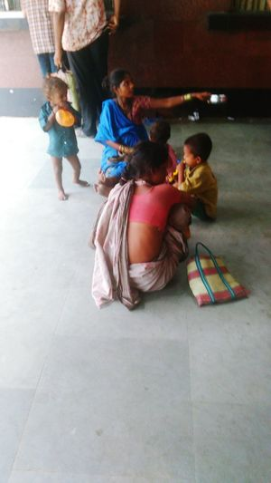 Mother Begging ,Son Playing