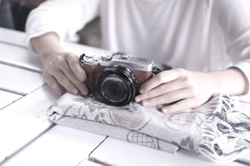 Close up of man holding camera