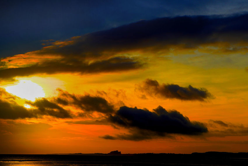 Orange dawn Bamburgh Castle North Sea Coast Beauty In Nature Cloud - Sky Dawn Dramatic Sky Idyllic Nature No People Northumberland Coastline Orange Color Outdoors Scenics Sea Silhouette Sky Sunset Tranquil Scene Tranquility Water Winter Dawn