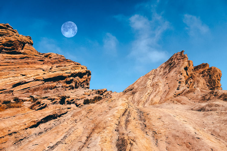 Vasquez Rocks Arid Climate Beauty In Nature Blue Climate Cloud - Sky Environment Eroded Formation Geology Land Moon Mountain Nature No People Non-urban Scene Outdoors Physical Geography Rock Rock - Object Rock Formation Scenics - Nature Sky Solid Tranquil Scene Tranquility
