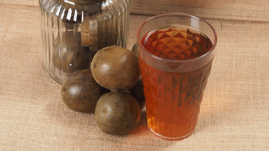 High angle view of fruits in glass jar on table