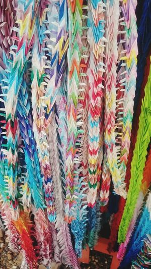 A lot paper cranes in Japan Multi Colored Hanging No People Full Frame Outdoors Close-up Day Backgrounds EyeEmNewHere Paper Cranes Japanese Culture Japan Memories Japanese Temple