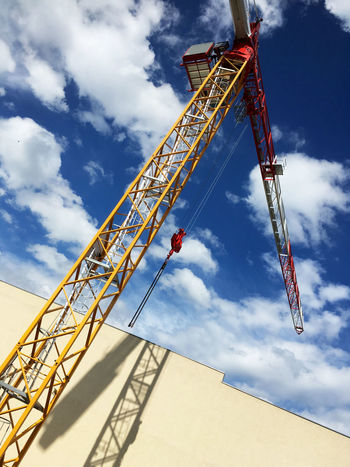 Big yellow crane for construction work. Blue Skies Building Building Crane Built Structure Cloud - Sky Clouds Constrction Work Construction Crane Day In Progress  Low Angle View No People Outdoors Sky Sunlight Work Young Adult