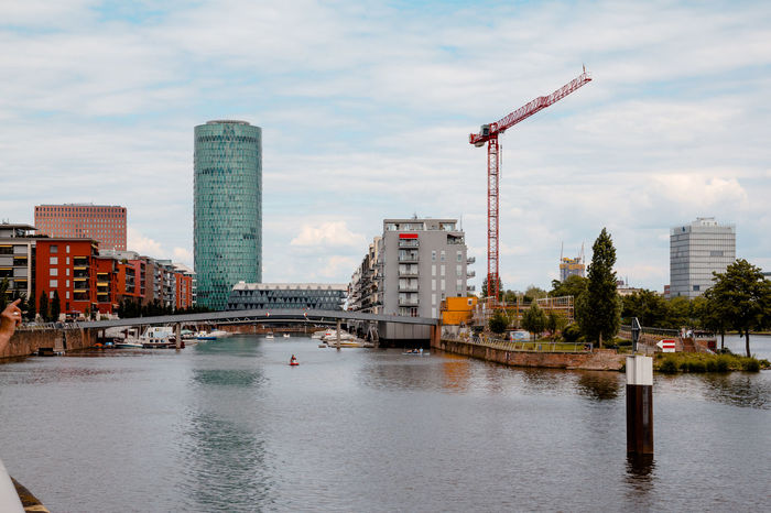 Westhafen Architecture Building Exterior Built Structure Canal City Construction Site Crane Crane - Construction Machinery Day Development Engineering Growth Modern Office Building Outdoors River Riverbank Sky Skyscraper Tall - High Tower Water Waterfront Westhafen Westhafen Tower