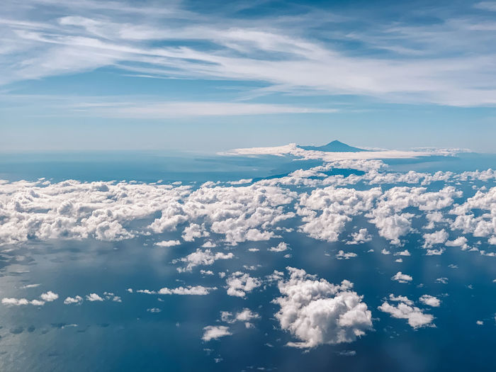 Aerial view of sea and volcano against sky