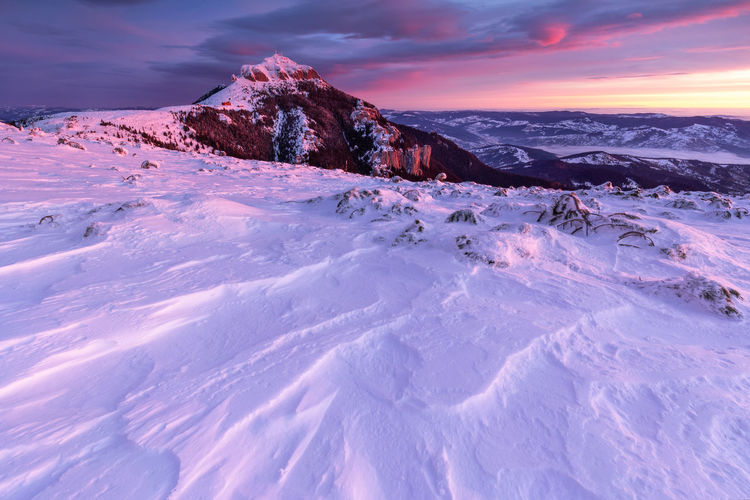 The beauty of winter on the snowy mountains on a cold day in ceahlau mountains - romania