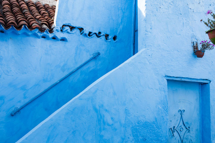 Close-Up Of A Blue Rustic House