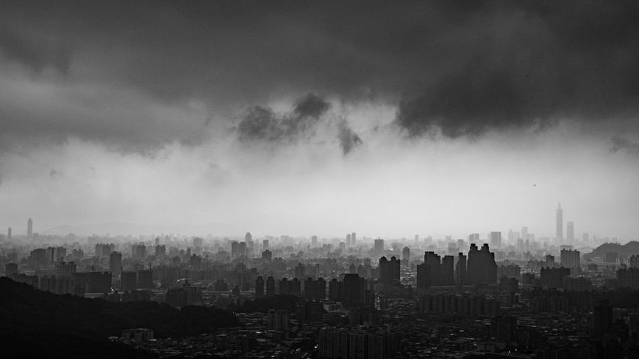 Aerial view of cityscape during storm clouds
