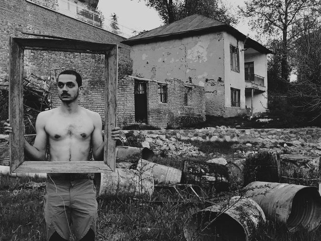 The Secret Spaces EyeEm Diversity Shirtless Human Representation Male Likeness Front View Day Outdoors Building Exterior Built Structure Architecture Men One Person Tree Young Adult Wrecked