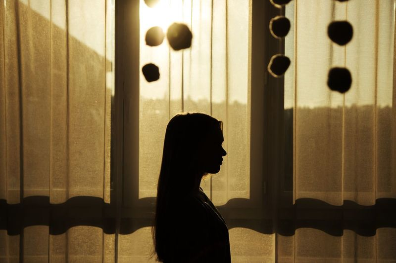 Silhouette Of Person By Window