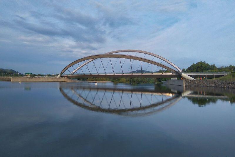 A reflection of a bridge Bridge Reflection Reflection Lake Overcast Waterfront Tranquil Scene Horizon Over Water The Architect - 2018 EyeEm Awards