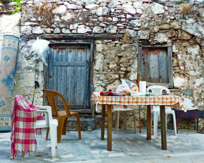 An early breakfast before a day's trekking Abandoned Architecture Building Exterior Built Structure Chair Damaged Day Door Lycianway Obsolete Relaxation Sitting Wall - Building Feature Window Lycian Way