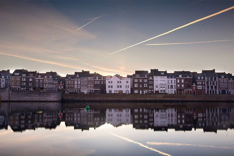 Reflection Sky Vapor Trail Architecture No People Building Exterior Water Waterfront Built Structure Outdoors Nature Cityscape City Day Maastricht Travel Destinations Nederland Holland Limburg Sunrise Reflection Architecture