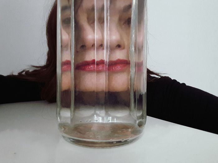 red lips Portrait Of A Woman Women Of EyeEm White Color Lips Redlips Red Color Face Trasparence Glass Reflection Water Water Reflections Close-up Transparent Glass - Material Floating In Water Drop