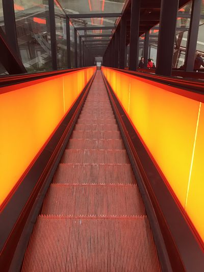 Architecture Transportation Direction Diminishing Perspective The Way Forward Built Structure Mode Of Transportation Railing Rail Transportation Empty No People Public Transportation Orange Color Indoors  Absence Illuminated Red Convenience vanishing point Modern