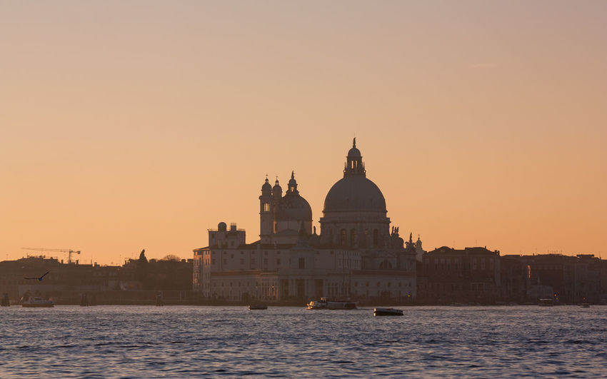 Grand canal against santa maria della salute during sunset