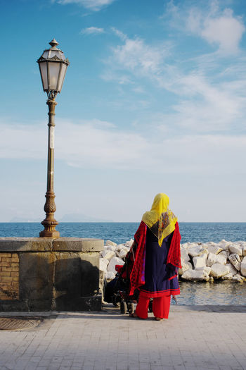 Rear View Of Woman In Sari Standing By Sea Against Blue Sky Dress India Indian Naples The Street Photographer - 2018 EyeEm Awards Tradition Clothing Culture Day Horizon Horizon Over Water Italy Lifestyles Looking At View Nature Outdoors People Real People Rear View Sari Sea Sky Water Women The Troublemakers Summer In The City