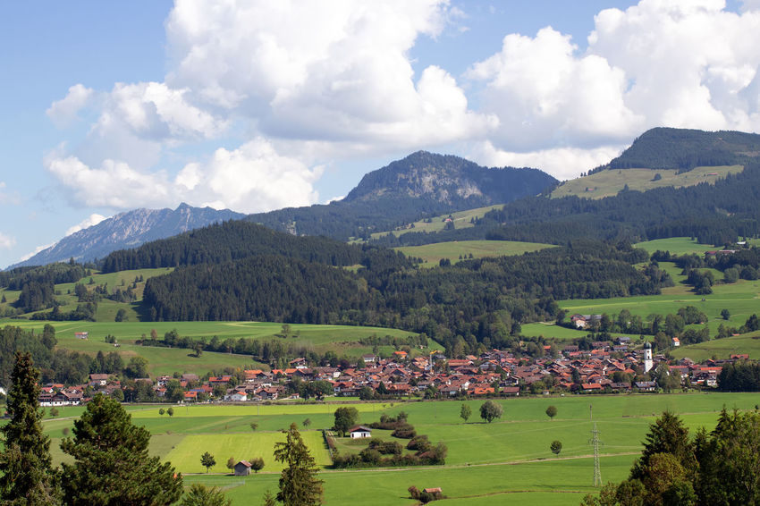 Landscape in Bavaria/Germany Agricultural Field Grasslands Valleys Tourist Destination Travel Destinations Travel Destination Villages Village Meadow Grassland Valley Panorama Mountains Mountain Countryside Agriculture Tranquility No People Nature Landscapes Landscape Allgäu Bayern Beauty In Nature Allgäu Alps