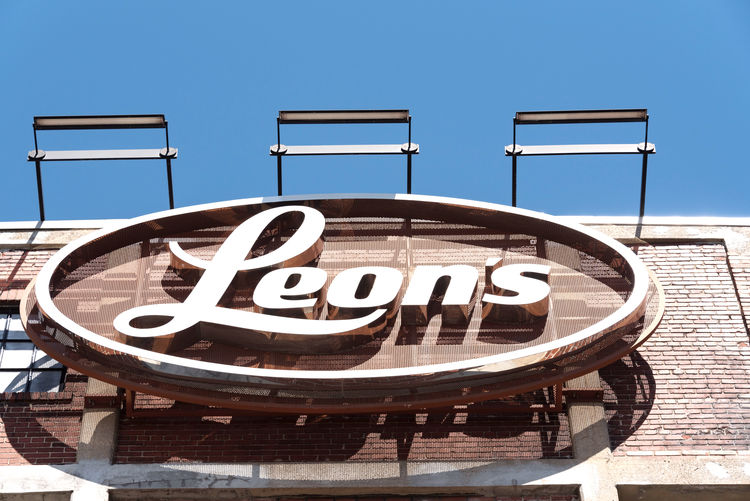 Leon's store shop sign located in water tank of the first Toronto train station. The landmark is part of the city heritage Blue Canada Canadian Culture Heritage History Information Information Sign Leon's Leon's Shop Leon's Store Log No People Old Buildings Outdoors Road Sign Sightseeing Sky Symbol Text Toronto Toronto Canada Toronto Culture Toronto Heritage Urban