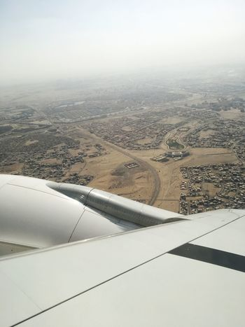 Aerial View Airplane Landscape Transportation Day Aircraft Wing Nature Air Vehicle Mode Of Transport Beauty In Nature Travel Jet Engine Outdoors No People Journey Scenics Airplane Wing Flying Patchwork Landscape Sky