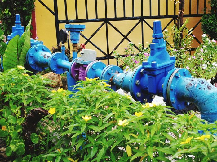 Blue Metal Close-up Green Color Oil Pump Water Pump Offshore Platform Drilling Rig Oil Industry Windmill Fire Hydrant